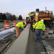 Placing Median Barrier Concrete, East Approach.