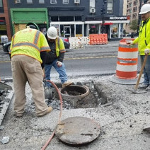 FMCC removing abandoned manhole top at 14th & U St