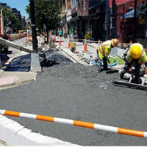 Placement and finishing of PCC sidewalk at NEC of 14th & S St.