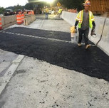 Asphalt wedge on NB-295 between sta. 11+75 and 12+75, right of the baseline.