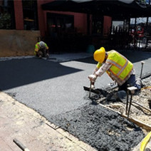 PCC sidewalk placement underway at NEC of 14th & T St by D.E.N.