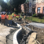 Installing granite circular curb at bump out at RT side of Raleigh SE SB Sta: 55+50 to 55+00