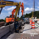 Demolishing existing bridge 1016 deck slab.
