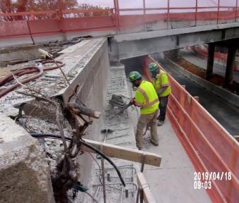 Demolishing existing beam seats on bridge 1016, abutment B