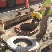Verizon Subcontractor setting the vault manholes to grade