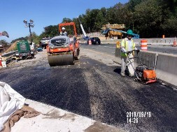 Compacting asphalt BM-25 on NB-295 between sta. 13+20 and 13+35, Lt of BL