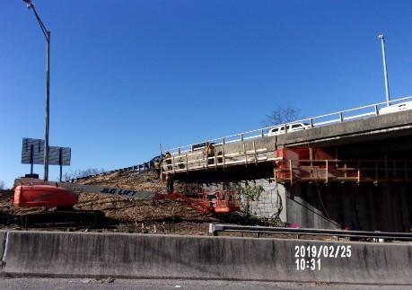 Installing work platform on Bridge 1016 Wing wall 2