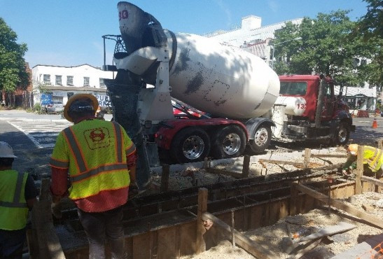 Concrete placement for trench drain underway.