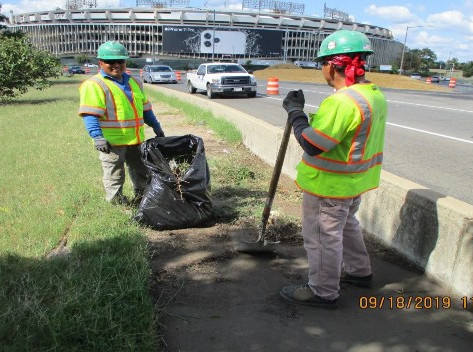 Cleaning Sidewalk along the South Bridge Prior to Detaouring the Pedestrian.