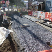 Installation of underdrain, #57 stones & Plant bed soil at MLK SB RT from Sta. 47+00 to Sta. 48+00