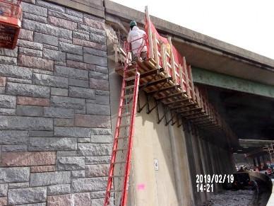 Demolishing top portion of Bridge 1017 Abutment A, Western Cheek Wall
