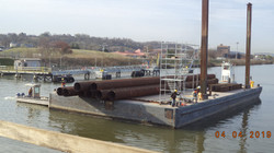 Barge Transporting Piling