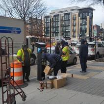 DCI installing a parking meter