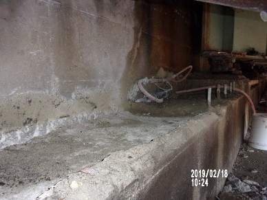 Demolishing top portion of Bridge 1017 Abutment A stem wall