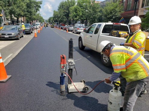 Geo-Tech Subcontractors collecting asphalt samples for testing