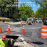 Saw cutting pavement for conduit trench between DDOT MH-C & DDOT MH-D