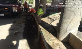 Installing forms for PCC barrier footer