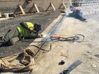 Welding metal plate on armored Joint bridge 1017 abutment A