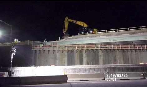 Demolishing Bridge 1017 parapet wall with crusher
