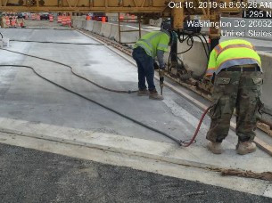 Roughened bridge 1016 deck slab in preparation for latex concrete