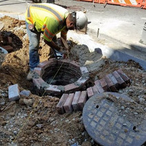Adjusting Sewer Manhole at the NE corner of N Street Eastside