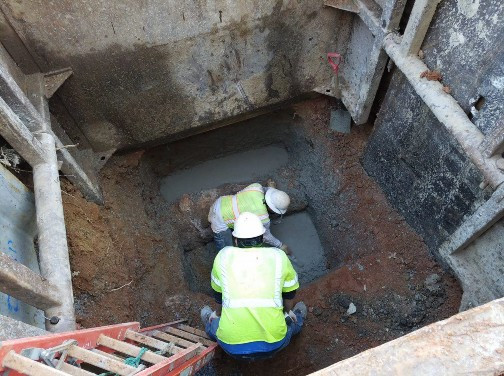 Placement of PCC base for Brick Combine Sewer Manhole