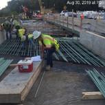 Installing rebars bridge 1016 abutment B approach slab, left of the baseline.
