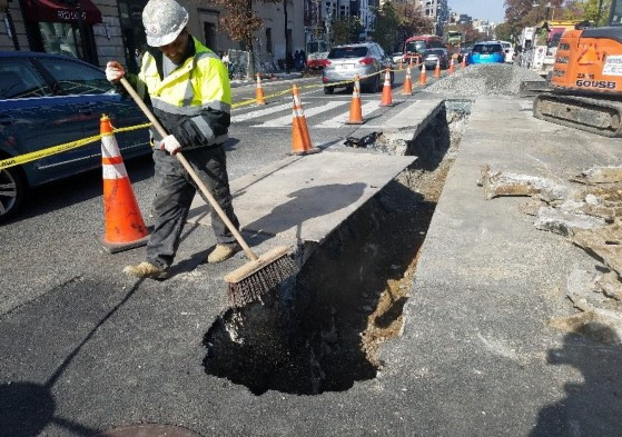 Asphalt placed at 1357 14th St water main tie-in.