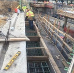 Installing forms on SB-295, bridge 1017 abutment A stemwall and beam seats.