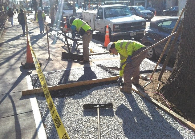Capital Flexi Pave placing porous flexible pavement on NB 14th Street across from 1738 14th Street NW