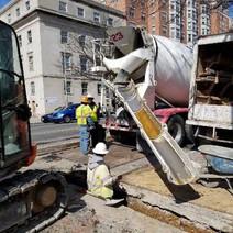 Placing PCC Concrete for encasement of PVC Conduit