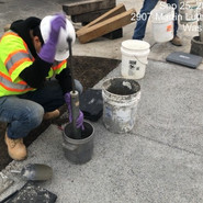 Testing pervious concrete for unit weight and void content prior to placement at 5th- Raleigh-Parkland-Malcolm X /MLK SB Sta: 50+50 to 63+50)- test performed on top of pervious concrete sidewalk placed a week before