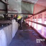 Cleaning existing rebars on Bridge 1017 Abutment B stem wall