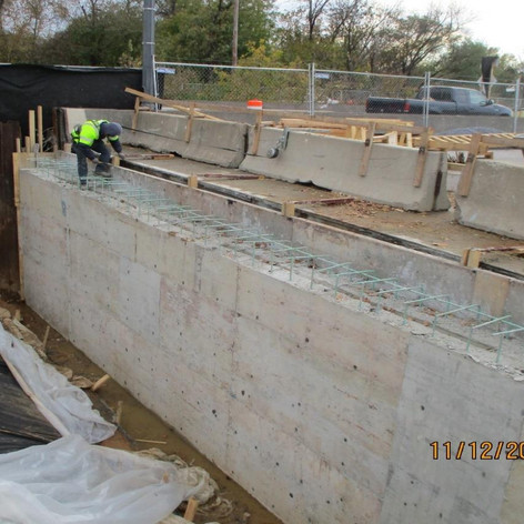 Removing Formworks at east Abutment Wall, North Bridge.