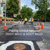 Placing conduit between DDOT MH-C & DDOT MH-D