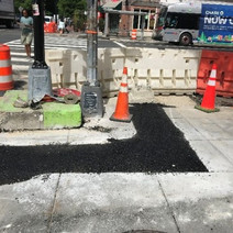 Placed and compacted cold mix asphalt utility trenches at the NEC of 14th and T St NW