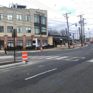 Installation of post metal and reflective median signs at Raleigh and MLK, SE