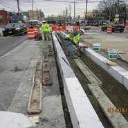 Installation of granite curb for new median on MLK between Mellon St to Malcom X Ave