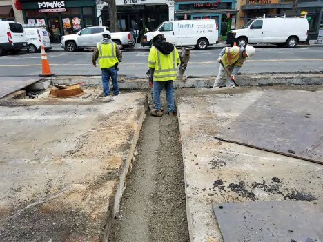 Contractor compacting Backfill Material Between N Street and Rhode Island Ave