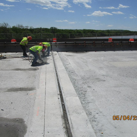 Saw Cutting and Chipping Along Strip Seal Joints, North Bridge.
