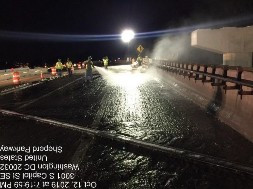 Powerwashing bridge 1016 deck slab in preparation for the placing of Latex concrete