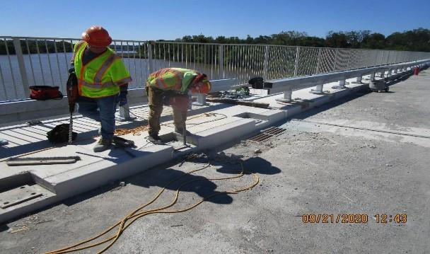 Installing Historic Railing, South Bridge.