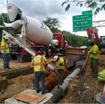 Placing concrete in pipe cradle