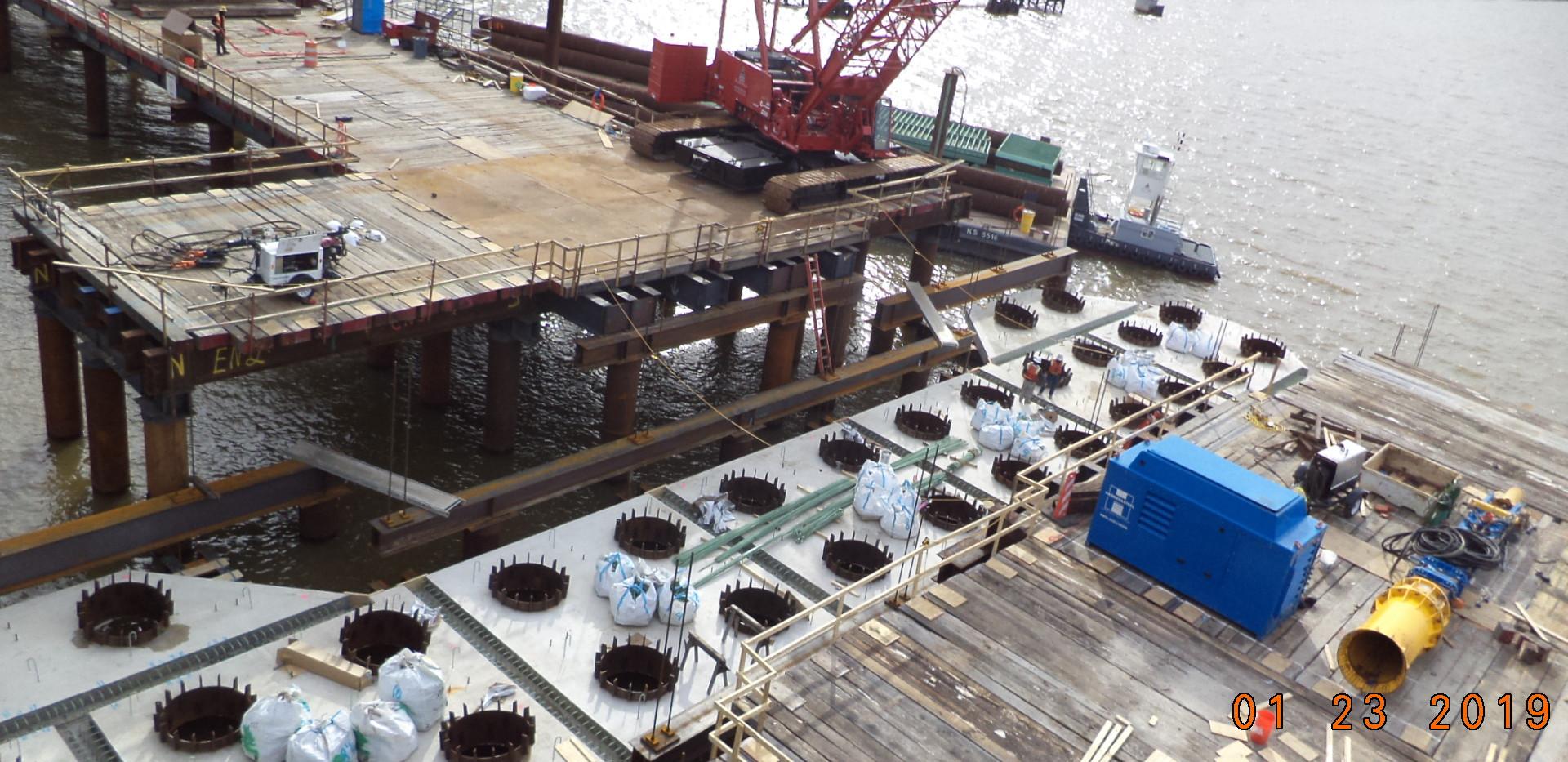 V-pier 2 crew setting soffit panels