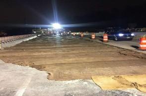 Burlap placed over Latex Modified Concrete bridge 1017