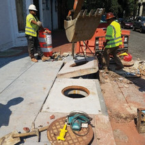 Adjustment of catch basin frame top at Corcoran St by Omni
