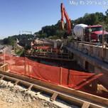 Placing concrete on Bridge 1017 abutment A, left of baseline