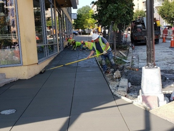 DEN placed PCC Sidewalk at 2300 Block in Front of 7-Eleven Store at 14th St. NW.
