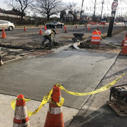 Placing driveway restoration at 3rd gate of Homeland Security (Double Grate Inlet) (STA: 72+50 RT SB)