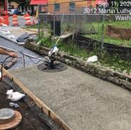 Placing pervious concrete sidewalk at Parkland-Malcolm X - Mellon to Lebaum/MLK NB Sidewalk (Sta: 56+50-63+50)